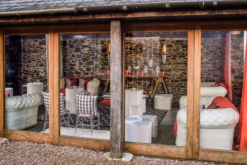 The Cart Shed, at Aikwood Tower, near Selkirk, in the Scottish Borders. The barn was styled by wedding planning and prop hire company 'Get Knotted'. The company, run by Lindsey Hunter, from her base in the Scottish Borders, designs, styles, organises and supplies for a wedding.