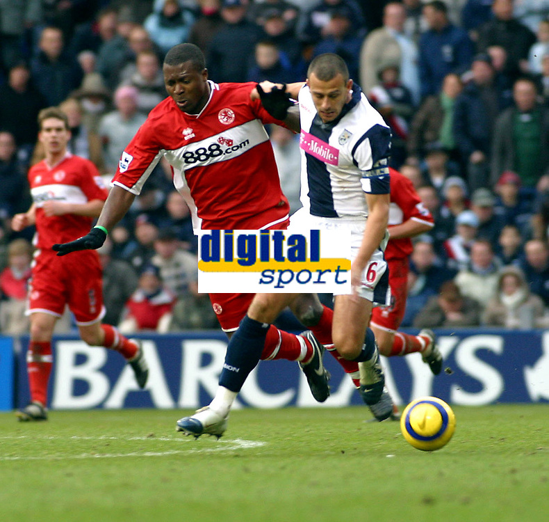 Photo: Dave Linney.<br />West Bromwich Albion v Middlesbrough. The Barclays Premiership. 26/02/2006West Brom's .Neil Clement (R)beats  Aiyegbeni Yakuba to the ball