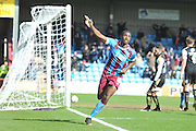 Hakeeb Adelakun of Scunthorpe United celebrtates scoring goal for Scunthorpe to go 3-0 up  during the Sky Bet League 1 match between Scunthorpe United and Swindon Town at Glanford Park, Scunthorpe, England on 28 March 2016. Photo by Ian Lyall.