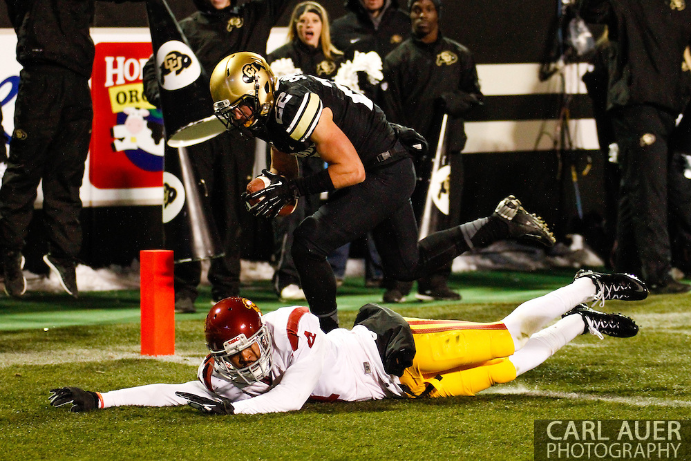 November 23rd, 2013:  Colorado Buffaloes sophomore wide receiver Nelson Spruce (22) scores a touchdown past the diving USC Trojans senior corner back Torin Harris (4) in the fourth quarter of the NCAA Football game between the University of Southern California Trojans and the University of Colorado Buffaloes at Folsom Field in Boulder, Colorado