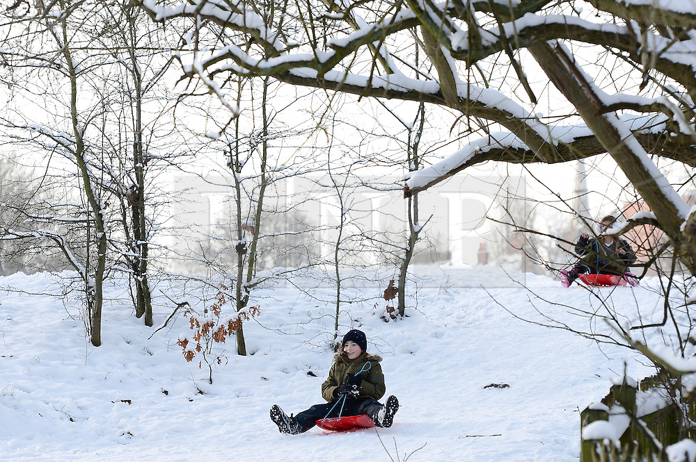 © Licensed to London News Pictures. 21/01/2013. London, United Kingdom.  Children play in the snow at Hampstead Heath North London as the capital experiences it's fourth day of snow.  Photo credit : Justin Setterfield/LNP