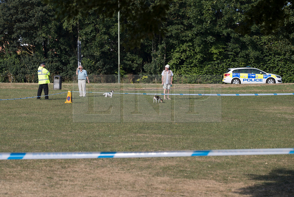 © Licensed to London News Pictures. 04/07/2018. Amesbury, UK. Residents talk to a police officer at a cordoned off area on the village green at Raleigh Crescent, Amesbury where it is thought  Dawn Sturgess, 44, and her partner Charlie Rowley, 45, may have visited for a family fun day before they were taken ill on Saturday 30th June 2018. Police have confirmed that the couple have been in contact with Novichok nerve agent. Former Russian spy Sergei Skripal and his daughter Yulia were poisoned with Novichok nerve agent in nearby Salisbury in March 2018. Photo credit: Peter Macdiarmid/LNP