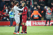 Liverpool goalkeeper Alisson Becker (13) and Liverpool midfielder Fabinho (3) celebrate the 4-0 win during the Champions League semi-final, leg 2 of 2 match between Liverpool and Barcelona at Anfield, Liverpool, England on 7 May 2019.