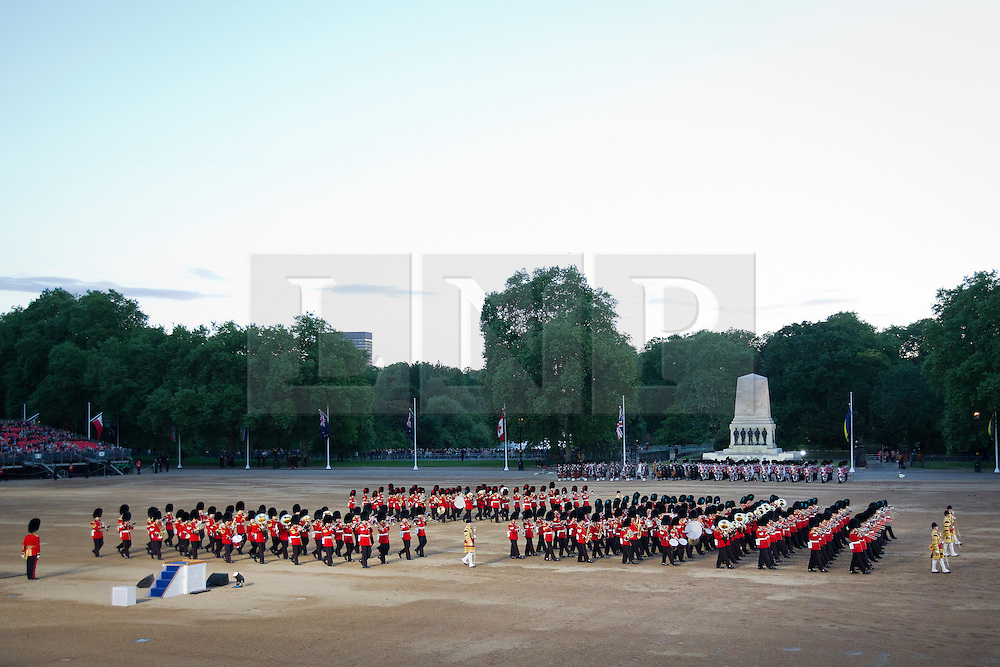 © Licensed to London News Pictures. 13/06/2013. London, UK. Musicians of the Household Division perform, with Her Majesty the Queen as guest of honour, during the annual Beating Retreat parade at Horse Guards Parade in London. On two successive evenings each year in June a pageant of military music, precision marching and colour takes place on Horse Guards Parade in the heart of London when the Massed Bands of the Household Division carry out the Ceremony of Beating Retreat. 300 musicians, drummers and pipers perform this age-old ceremony. The Retreat has origins in the early days of chivalry when beating or sounding retreat pulled a halt to the days fighting. Photo credit: Matt Cetti-Roberts/LNP