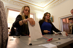 © licensed to London News Pictures. London, UK 04/03/2012. Russian citizens placing their votes in to ballot boxes at The Embassy of the Russian Federation in London as the election for the President of the Russian Federation takes place today (04/03/12). Photo credit: Tolga Akmen/LNP