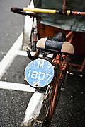 Rickshaw license plate.