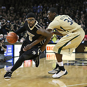 Central Florida guard Marcus Jordan (5) drives past guard Hugh Robertson (34) during the NCAA basketball game against the USF Bulls at the UCF Arena on November 18, 2010 in Orlando, Florida. UCF won the game 65-59. (AP Photo/Alex Menendez)