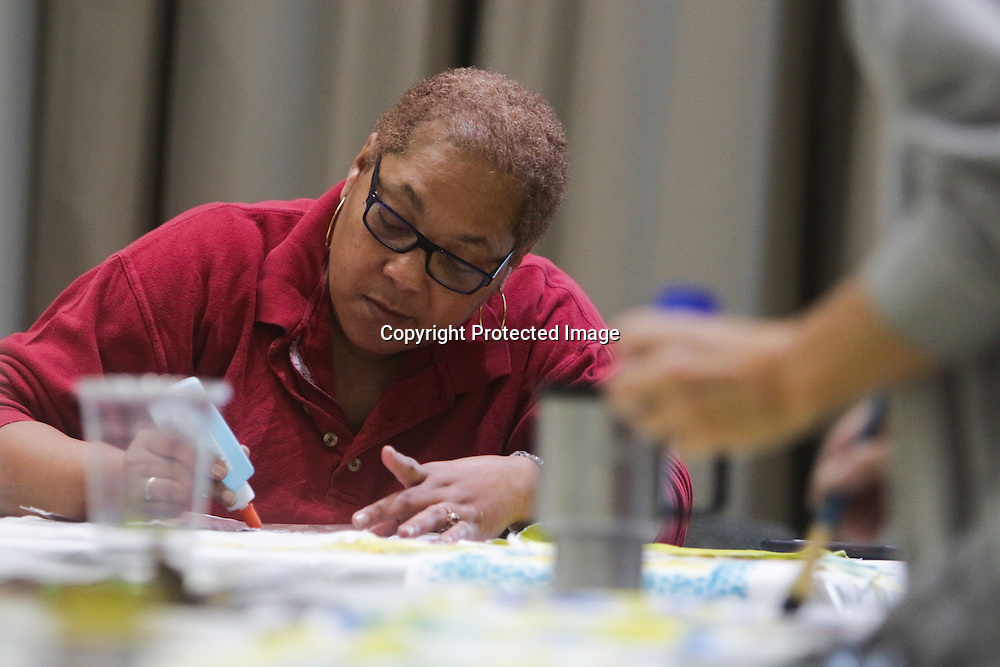 "Althea Johnson, left, and Mary Bryan paint quilt squares during ""Create Your Own Quilt Squares"" Sunday November 23, 2014 at the Cameron Art Museum in Wilmington, N.C. (Jason A. Frizzelle)"