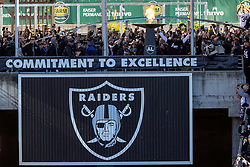 OAKLAND, CA - DECEMBER 15: Former player Charles Woodson of the Oakland Raiders lights the Al Davis Commitment to Excellence torch before the game against the Jacksonville Jaguars at RingCentral Coliseum on December 15, 2019 in Oakland, California. The Jacksonville Jaguars defeated the Oakland Raiders 20-16. (Photo by Jason O. Watson/Getty Images) *** Local Caption *** Charles Woodson