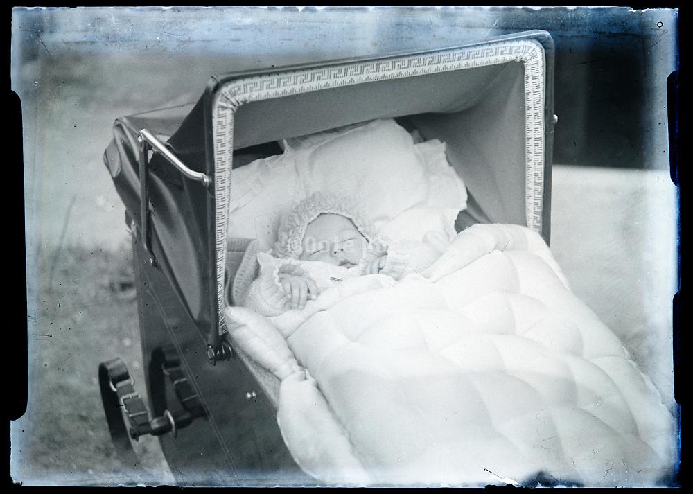 baby sleeping in stroller France circa 1920s