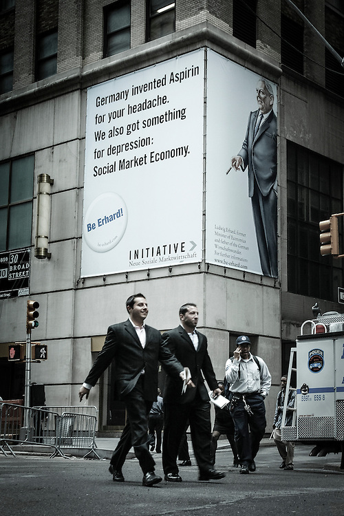 "A German company ad says ""Germany invented Aspirin for your headache. We also got something for depression: Social Market Economy"". The ad was strategically placed on the corner opposite the NYSE - New York Stock Exchange at the height of the depression."