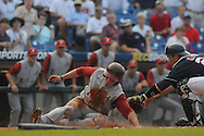 Alabama's Taylor Dugas gets around the tag of Mississippi catcher Miles Hamblin and scores during the Southeastern Conference tournament at Regions Park in Hoover, Ala. on Thursday, May 27, 2010. Alabama won 6-3. (AP Photo/Oxford Eagle, Bruce Newman)