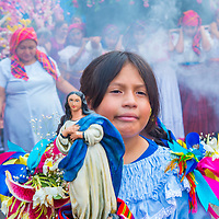 PANCHIMALCO , EL SALVADOR - MAY 08 : Salvadoran girl participate in the procession of the Flower & Palm Festival in Panchimalco, El Salvador on May 08 2016