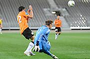 Mark Paston clears the ball for the Phoenix, A-League football pre season match - Wellington Phoenix v Brisbane Roar at Forsyth Barr Stadium, Dunedin, New Zealand on Saturday, 20 August 2011. Photo: Richard Hood/photosport.co.nz