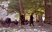 """FBI Agents and other Federal Agents comb the cemetery on their hands and knees searching for evidence from the Sept. 11th attack at the World Trade Center in the cemetery at Trinity Church. Through my eyes and with my camera I am able to see the world we live in, and try to bring things into focus. Photography preserves my vision of what """"I see"""" at a specific time and place- a moment. Creating a bond between  me and my subject and capturing and emotion for eternity. Having lived and worked in New York City for over 15 years when 911 happened. I had to go and """"see"""" with my camera what lower Manhattan was like after this horrific attack on our Nation. The World Trade Center owned the skyline in lower Manhattan making it feel more like a canyon. After the Twin Towers fell, and I saw with my own eyes and camera the destruction, I realized what little land they actually sat on. The Twin Towers may not have occupied a large plot of land but they now touched everyones life. Photo©SuziAltman"""