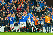 Sheyi Ojo (#11) of Rangers FC is mobbed by his team mates after scoring the opening goal during the Europa League match between Rangers FC and Feyenoord Rotterdam at Ibrox Stadium, Glasgow, Scotland on 19 September 2019.