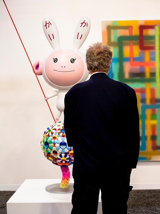"Visitor confonts sculpture ""Kaikai Kiki"" by Takashi Murakami at Galerie Emmanuel Perotin, Art Basel Miami Beach 2007"