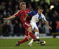 Photo: Jonathan Butler.<br />Blackburn Rovers v Liverpool. The Barclays Premiership. 26/12/2006.<br />David Bentley is tackled by Dirk Kuyt of Liverpool.