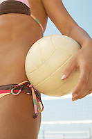 Beach Volleyball Player Holding Volleyball