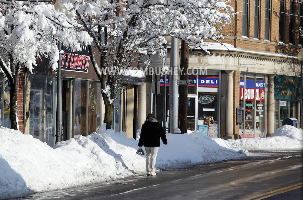 Middletown, New York - A woman walks on a downtown street on the morning after a storm dumped two feet of snow on the area. Feb. 27, 2010.