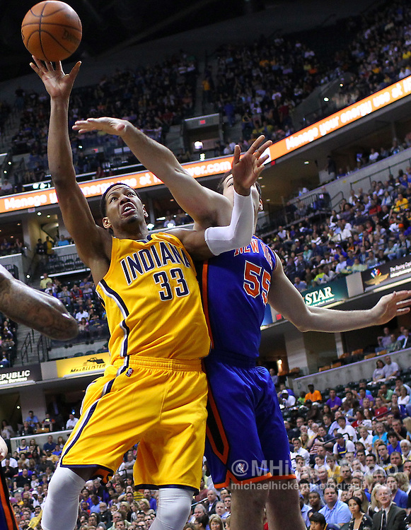 April 03, 2012; Indianapolis, IN, USA; Indiana Pacers small forward Danny Granger (33) shoots the ball as New York Knicks forward Josh Harrellson (55) defends at Bankers Life Fieldhouse. Mandatory credit: Michael Hickey-US PRESSWIRE