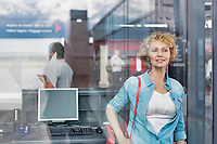 Portrait of mature woman boarding her flight in airport