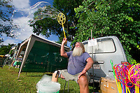 A local man selling giant bubble makers at the Yungaburra Markets, one of the Atherton Tablelands' most popular attractions.