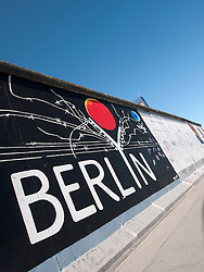 paintings on Berlin Wall at East Side Gallery in Berlin Germany