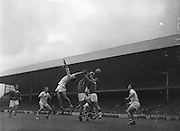 Cork forwards, D. Moynihan, Coughlan and L.O'Hanrahan tussle among themselves during the All Ireland Minor Gaelic Football Final Cork v. Galway in Croke Park on the 26th September 1960.