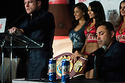 Oscar De La Hoya sets up Canelo Alvarez's new WBO light middleweight belt as Alvarez speaks to the media after defeating Liam Smith in front of over 51,000 fans at AT&T Stadium in Arlington, Texas on September 17, 2016.  (Cooper Neill for ESPN)