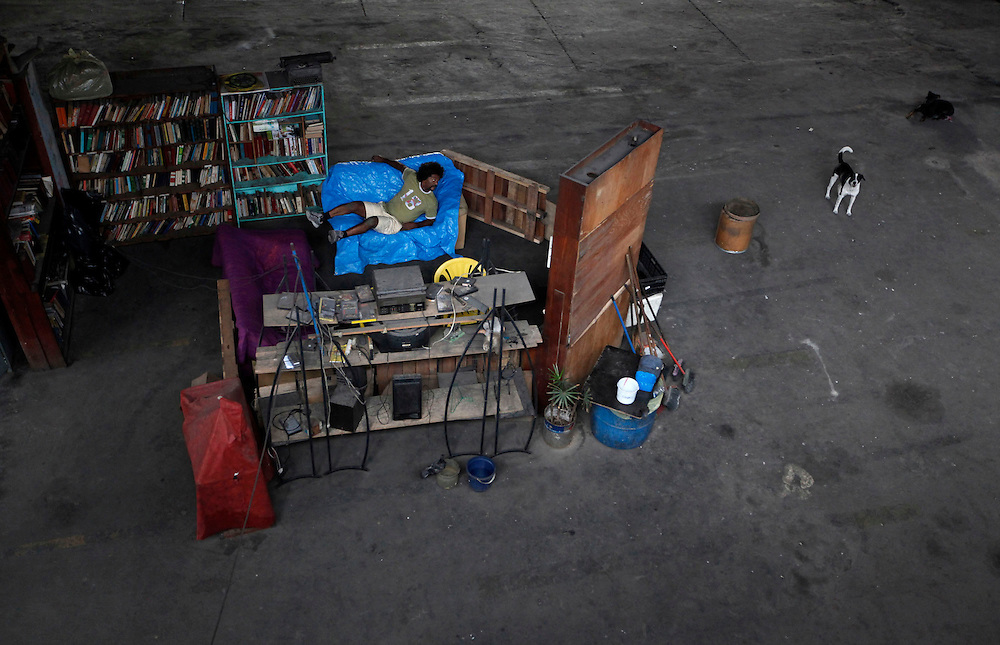 Brazilian former pro boxer Nilson Garrido rests in his den that occupies part of a parking lot where his gymnasium operates under the the Alcantara Machado viaduct in the Mooca neighborhood of Sao Paulo, March 15, 2011. The Boxing Academy of Garrido adopts primitive training equipment that he developed himself during his years as a coach, in a project whose goal is to take the sport to the poor and marginalized population.