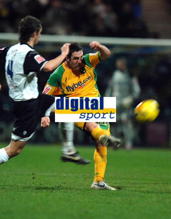 Photo: Paul Greenwood.<br />Preston North End v Norwich City. Coca Cola Championship. 20/02/2007. Norwich's, Mark Fotheringham clears under pressure form Danny Pugh