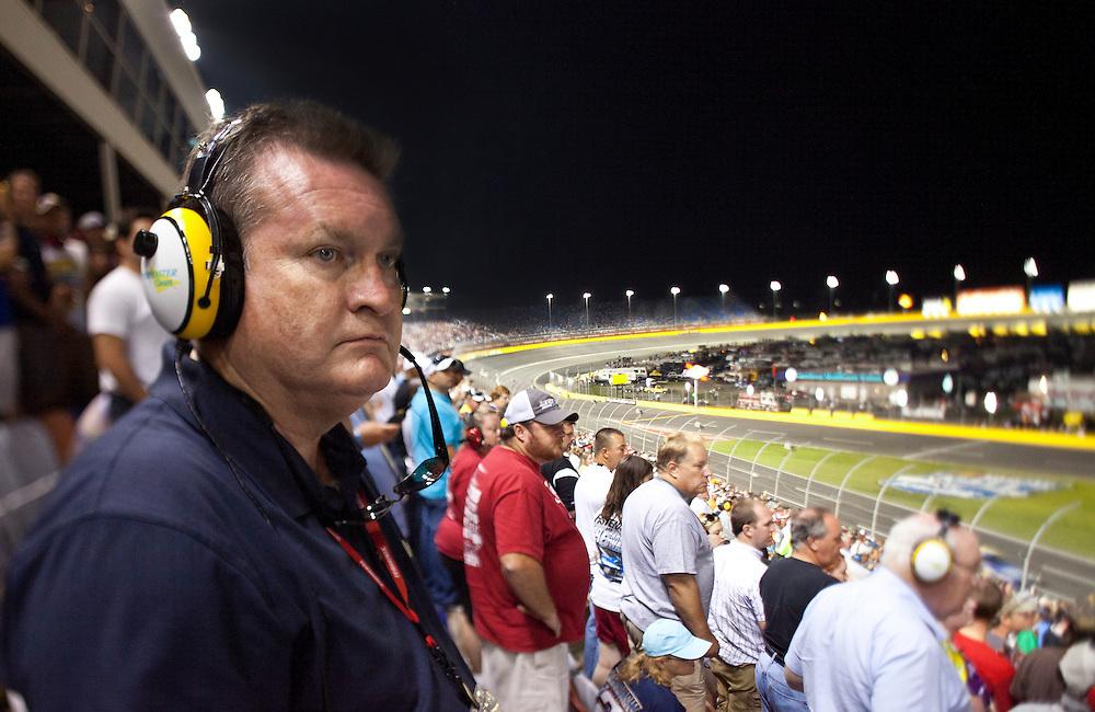 race fans enjoying a night race at Charlotte, Motor Speedway