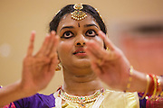 10 AUGUST 2012 - PHOENIX, AZ:   A woman dances during the celebration of Janmashtami at Ekta Mandir, a Hindu temple in central Phoenix. Janmashtami is the Hindu holy day that celebrates the birth of Lord Krishna. Hindu communities around the world celebrate the holy day. In Arizona, most of the Hindu temples in the Phoenix area have special celebrations of the day.  PHOTO BY JACK KURTZ