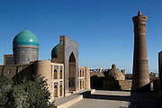 High angle view of the Mir-i-Arab Madrasah, 1535, (left) and the Kalyan Minaret, 12th century, (right) Bukhara, Uzbekistan, pictured on July 11, 2010 in the afternoon. The Mir-i Arab Madrasah was built by the Shaybany Ubaydallah Khan, and is still a functioning madrasah. The baked brick minaret, commissioned by Arslan Khan and designed by Bako, is 48 metres high and its diametre is 9 metres at the bottom and 6 metres at the top. Bukhara, a city on the Silk Route is about 2500 years old. Its long history is displayed both through the impressive monuments and the overall town planning and architecture. Picture by Manuel Cohen.