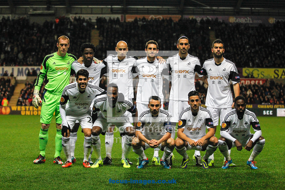 Picture by Mike  Griffiths/Focus Images Ltd +44 7766 223933<br /> 28/11/2013<br /> The Swansea City squad line up against Valencia Club de F&uacute;tbol during the UEFA Europa League match at the Liberty Stadium, Swansea.