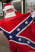 Santa Claus holds a Confederate flag outside the Redneck Shop December 5, 2009 in Laurens, SC during the 7th Annual White Unity Christmas Party held by the American Nazi Party & International Knights of the Ku Klux Klan.