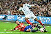 England Forward Raheem Sterling tackled by Spain defender Cesar Azpilicueta during the International Friendly match between England and Spain at Wembley Stadium, London, England on 15 November 2016. Photo by Mark Davies.