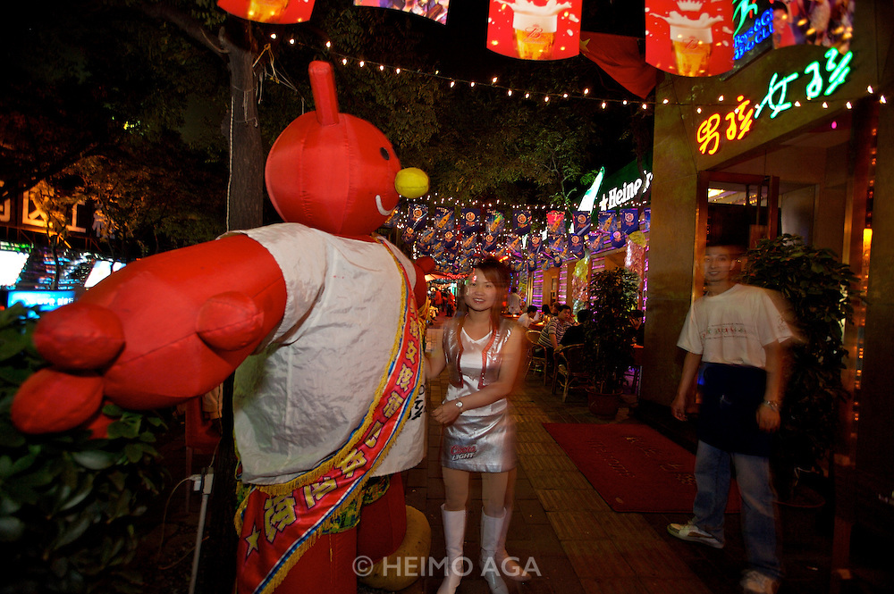 Sanlitun bar street nightlife district. Boys & Girls Club. Plush bear attracting attention.