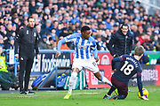 Jan Siewert of Huddersfield Town (Manager) and Unai Emery of Arsenal (Manager) watch on as Adama Diakhaby of Huddersfield Town (11) is tackled by Nacho Monreal of Arsenal (18) during the Premier League match between Huddersfield Town and Arsenal at the John Smiths Stadium, Huddersfield, England on 9 February 2019.