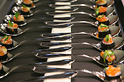 Caviar displayed on spoons at a formal meal celebration