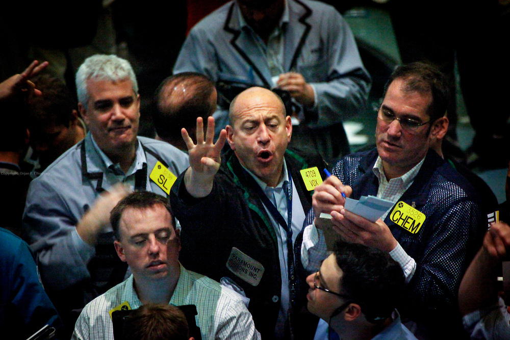 Ray Carbone (c) shouting with fellow traders on the trading floor of the NYMEX New York Mercantile Exchange. These traders are buying and selling in oil and natural gas options.