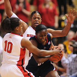 Mar 2, 2009; Piscataway, NJ, USA; Rutgers center Kia Vaughn (15) helps guard Epiphanny Prince (10) force a turnover from Connecticut guard Kalana Greene (32) during the second half of Rutgers game against nationally rated #1 Connecticut at the Louis Brown Athletic Center.  Connecticut won 69-59 to finish their regular season a perfect 30-0.