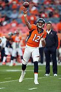 Denver Broncos quarterback Paxton Lynch (12) throws a pass while warming up before the 2016 NFL week 1 regular season football game against the Carolina Panthers on Thursday, Sept. 8, 2016 in Denver. The Broncos won the game 21-20. (©Paul Anthony Spinelli)