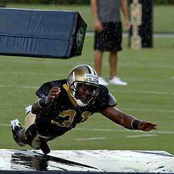 August 9, 2011; Metairie, LA, USA; New Orleans Saints safety Pierson Prioleau (31) runs a tackling drill  in a rain storm during training camp practice at the New Orleans Saints practice facility. Mandatory Credit: Derick E. Hingle