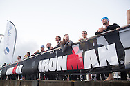 Spectators and competitors gather at the swim start. Ironman Cairns and Ironman Cairns 70.3 Race. 2013 Ironman Cairns Triathlon Festival. Cairns, Queensland, Australia. 09/06/2013. Photo By Lucas Wroe
