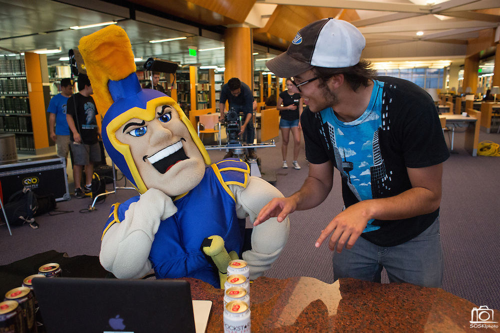 Director Darren H. Rae, San Jose State University Radio, Television, and Film graduate ('12), of Spartan Film Studios talks with Kiara Tomasello, hospitality sophomore, inside the Sammy Spartan mascot, before filming Sammy Spartan Graduates at Dr. Martin Luther King, Jr. Library in San Jose, California, on May 2, 2013. (Stan Olszewski/SOSKIphoto)