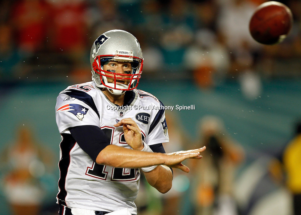 New England Patriots quarterback Tom Brady (12) releases a pass during the NFL week 1 football game against the Miami Dolphins on Monday, September 12, 2011 in Miami Gardens, Florida. The Patriots won the game 38-24. ©Paul Anthony Spinelli