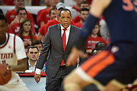 Men's basketball coach Kevin Keatts (center) watches his offense work a play during 2nd half action against UVA.