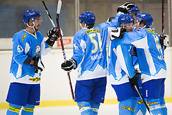 Players of HK Trigalv Kranj celebrate scoring a goal during Inter National League ice hockey match between HK Triglav Kranj and EHC Palaoro Lustenau, on October 7, 2012 in Ledena Dvorana, Kranj, Slovenia. (Photo by Matic Klansek Velej / Sportida.com)